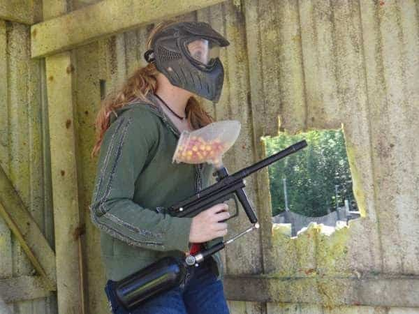 girl playing paintball